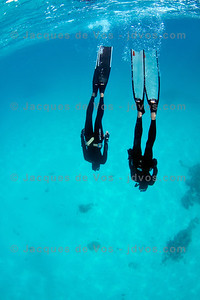 In Time  Stefan Randig and Linda Paganelli diving just south of Dahab, Egypt.  Ikelite 7D Housing (8'' Dome Port) Ikelite DS-161 Strobes
