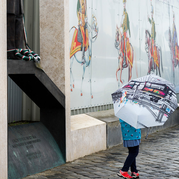 Person carrying an umbrella while walking on street at Buda's Castle District, Budapest, Hungary