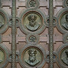 Carvings of faces on the door of St. Stephen's Basilica, Budapest, Hungary