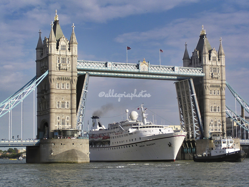 Ship passing under Tower Bridge, London