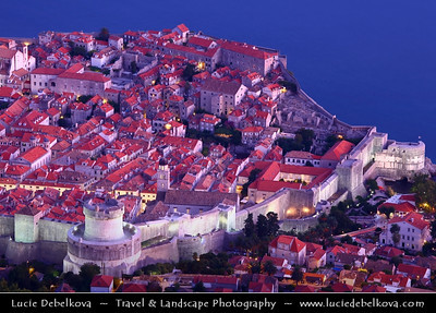 Europe - Croatia - Dubrovnik - Pearl of the Adriatic - Old Mediterranean city on the Adriatic Sea coast in the extreme south of Croatia - UNESCO World Heritage Site - View over the City and Nearby Landscape from Hill Above - Dusk - Twilight - Blue Hour