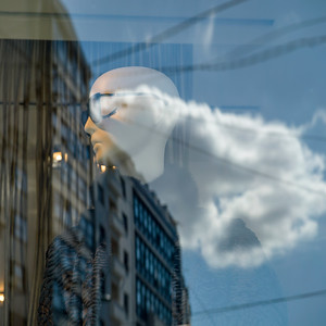 Reflection of a clouds and building on the glass, Belgrade, Serbia