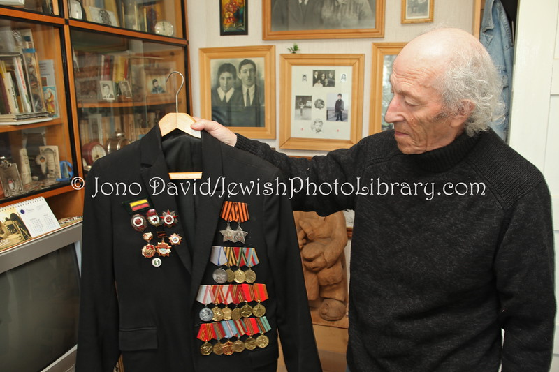 LT 1617  Yacov Bunka, wood carver and sculptor, shows off his medals