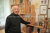 LT 1623  Yacov Bunka stands with his wood carvings