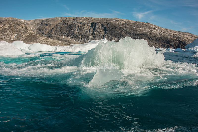 Ice block  shooting to the surface in Sermilik Fjord
