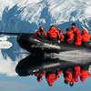 Zodiac speeding through the icefield, Sermilik Fjord