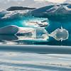A turquoise ice cave on an iceberg, Sermilik Fjord