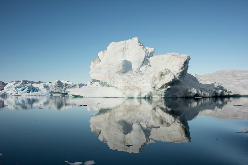 Mirror reflection of an Iceberg in Sermilik Fjord