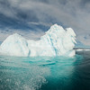 Spray from the Zodiac splashes an iceberg