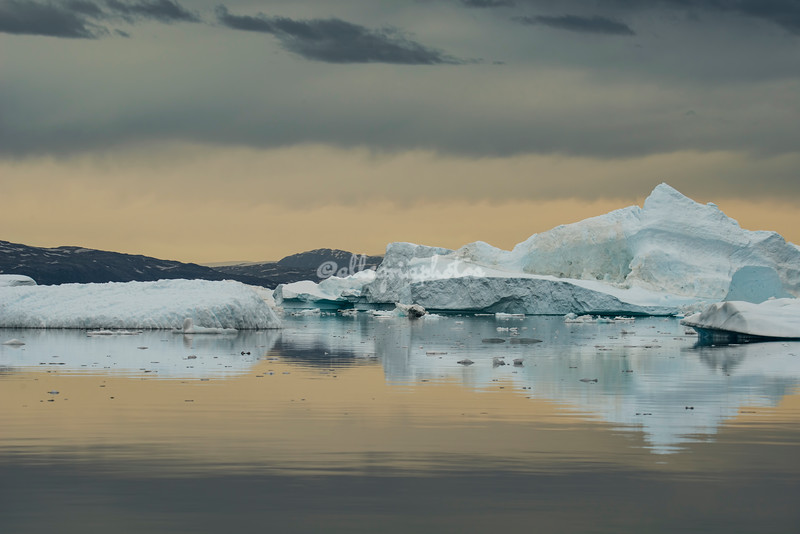 The icebergs at sunset on a cloudy day, Sermilik Fjord