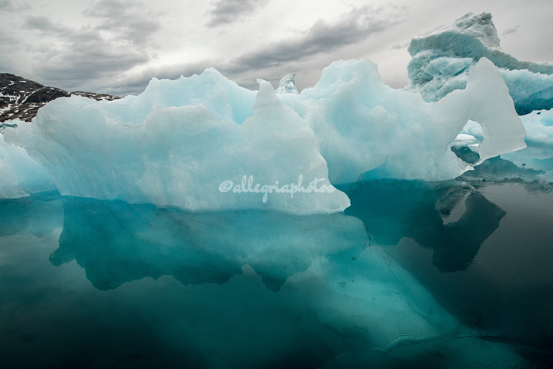 Turquoise blue of the portion of the iceberg under the water