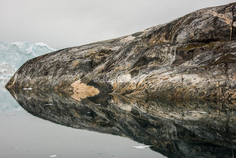 Mirror image of island promontory
