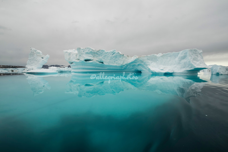 A vast amount of the iceberg is under the water.