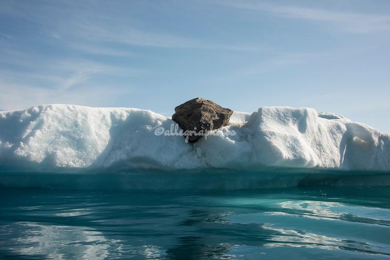 "An ""erratic"" rock on top of an iceberg,Sermilik Fjord"