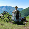 Cyclist resting near Gergeti Monastery