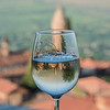 Signaghi Basilica reflected in glass of White Wine
