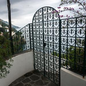Entrance gate at waterfront, Positano, Amalfi Coast, Salerno, Campania, Italy