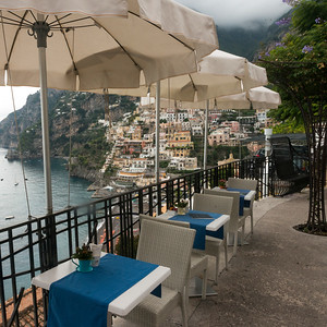 Empty chairs and tables with a patio umbrellas on terrace, Positano, Amalfi Coast, Salerno, Campania, Italy