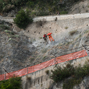 Workers repelling down a cliff, Amalfi, Amalfi Coast, Salerno, Campania, Italy