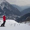 Tourist snowboarding, Alpine Resort, Aosta Valley, Courmayeur, Northern Italy, Italy