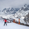 Woman skiing in snow, Alpine Resort, Aosta Valley, Courmayeur, Northern Italy, Italy