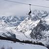 Chair lift over ski resort, Alpine Resort, Aosta Valley, Courmayeur, Northern Italy, Italy