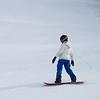 Female tourist snow boarding, Alpine Resort, Aosta Valley, Courmayeur, Northern Italy, Italy