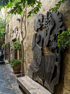 Sculptures on wall, Orvieto, Terni Province, Umbria, Italy