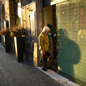 Woman entering in a shop, Orvieto, Terni Province, Umbria, Italy