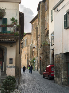 People walking in a narrow street, Orvieto, Terni Province, Umbria, Italy