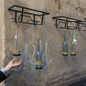 Decorative bottle lamps hanging on a wall, Orvieto, Terni Province, Umbria, Italy