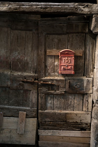 Mail box mounted on a dilapidated door, Orvieto, Terni Province, Umbria, Italy