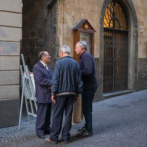 Group of three senior men on street, Orvieto, Terni Province, Umbria, Italy