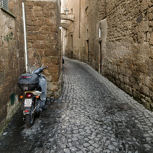 View of a scooter in an alley, Orvieto, Terni Province, Umbria, Italy