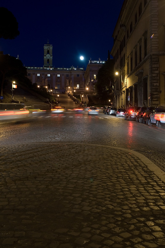 Museo di Roma with the full moon rising and traffic around the Piazza Venezia