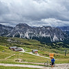 A cyclist prepares to descend the mountain from the Seceda cable car, South Tyrol, Dolomites.