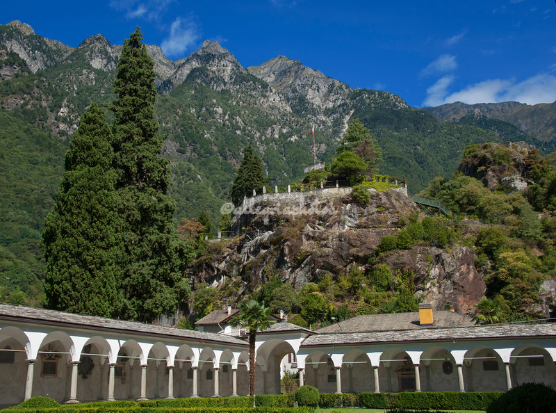 The Romanesque College of San Lorenzo overlooked by the 15th century Castello di Chiavenna, Lombardy, Italy