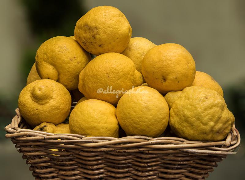 A basket of lemons outside a restaurant in Rome