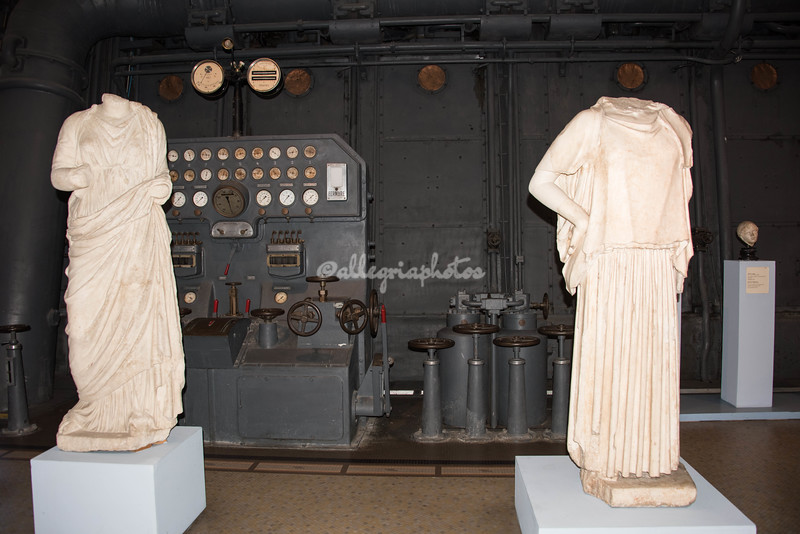 Headless marble statues share space with electrical equipment, Museo Montemartini