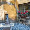 A 'Nasone' or drinking fountain, in an alleyway in central Rome.