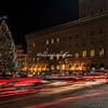 Traffic swirls around the Christmas tree on Piazza Venezia