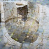 Dea Roma reflected in a puddle, Campidoglio