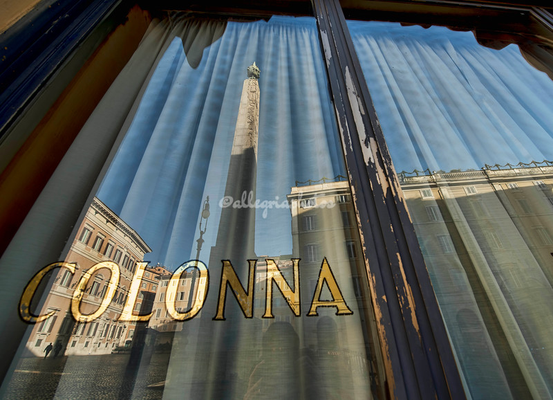 Reflections of the obelisk on Piazza Montecitorio