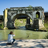 Photographing the Ponte Rotto (Broken Bridge) from the end of the Isola Tiberina