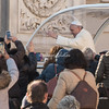 The Pope waving to the crowd from his Popemobile