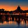 The dome of St Peter's and the Tiber River at sunset