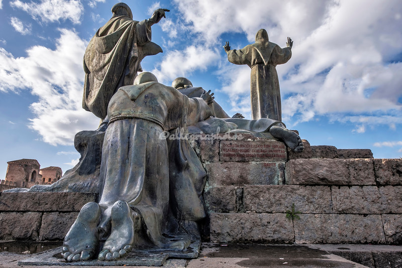 Statue of St Francis of Assisi and his disciples facing San Giovanni in Laterano, Rome