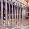 Nun walking beside enormous columns, San Paolo Fuori le Mura