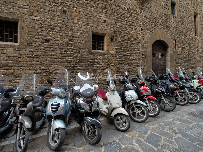 Motor Scooters parked along the ancient walls of The Museo Bargello, Florence