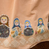 Detail of Russian dolls on skirt,